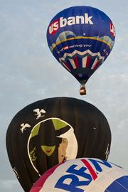 "The U.S. Bank hare balloon drifted above the participants in the hare-and-hound race Friday morning. The hare balloon takes off and the other balloonists ""chase"" the hare."