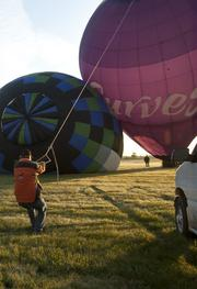 A crew member steadied the Curves fitness centers hot-air balloon prior to lift off in the U.S. Bank Kentucky Derby Festival Great Rush-Hour Race.