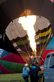 A hot-air balloon is prepared for lift off in the rush hour race on Friday.
