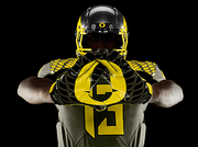 The olive home uniform was inspired by former Duck linebacker Art Miller's  service in the U.S. Army's 41st Division. Miller played linebacker for the Ducks as a freshman in 1939 before joining the National Guard and being called to active service. He served more than 29 years and eventually retired as a Lieutenant Colonel.