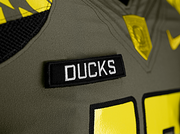 The black patch on the chest is reminiscent of identification patches on military uniforms. After the scrimmage, Oregon football players will present the specially made jerseys to about 100 uniformed men and women from all branches of the military.