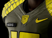 "The Spring Game uniforms' military theme is showcased by the badge on the neckline that says ""Support Our Troops."""