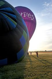The early morning light illuminated the Curves fitness centers balloon.