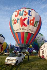 "The Kosair Children's Hospital balloon promotes the hospital with its ""Just for Kids"" slogan."