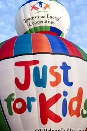 The Kosair Children's Hospital balloon waited its turn to take off in the rush-hour race.