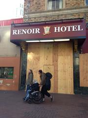 The plywood is up at the Renoir Hotel