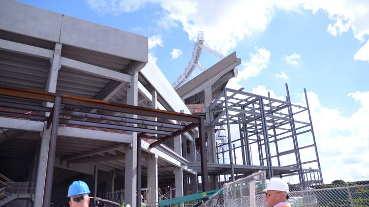 Renovations at the Citrus Bowl stadium halted just long enough to celebrate the halfway point of pre-cast bowl construction.