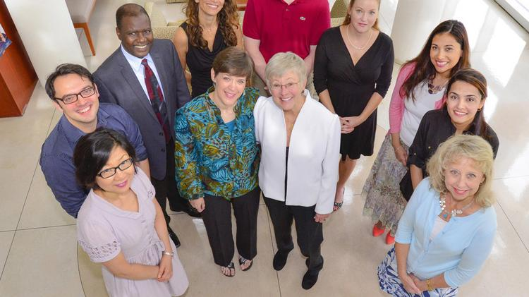 Julie Baldwin, center left, and Carol Bryant, center right, lead the newly funded Florida Prevention Research Center based at the USF College of Public Health. They are surrounded by some members of the center's team, including researchers from Moffitt Cancer Center.