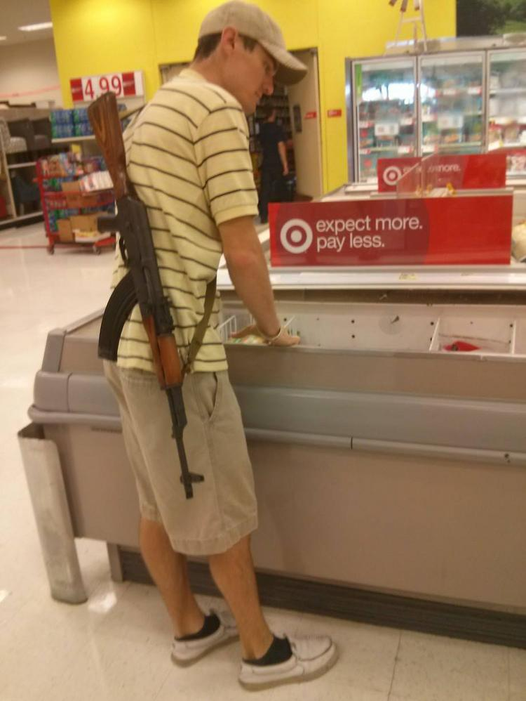 A gun-rights group caused an uproar after posting photos of members carrying rifles in Dallas-area Target stores.