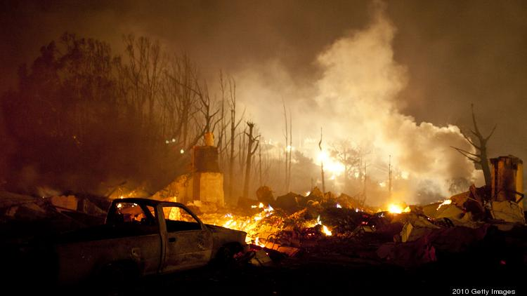 SAN BRUNO, CA - SEPTEMBER 9: Smoke rises near chimneys remaining after a massive fire in a residential neighborhood September 9, 2010 in a San Bruno, California. A massive explosion rocked a neighborhood near San Francisco International Airport. (Photo by Max Whittaker/Getty Images)