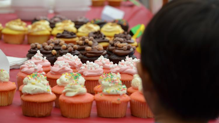 A Kids Business Inc. participant showcases his tasty cupcakes