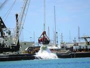 Work crews dredge the sea floor as part of the port's expansion.