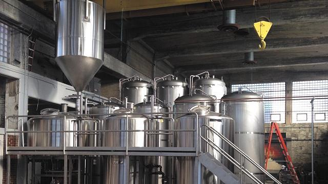 Warped Wing Brewing Company has purchased and installed four new 100-barrel fermenters.