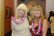Anne Murata, left, of the Pacific Aviation Museum Pearl Harbor and Patti Milburn of Cox Radio arrive at PBN's 2013 Women Who Mean Business event at The Royal Hawaiian hotel in Waikiki.
