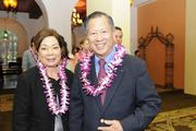 Patricia Tam, left, of Halekulani Corp. and Wesley Fong arrive at PBN's 2013 Women Who Mean Business event at The Royal Hawaiian hotel in Waikiki.
