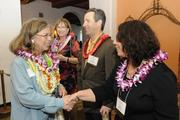 Gail Lerch of Hawaii Pacific Health, right, greets Kathryn William of Home Street Bank.