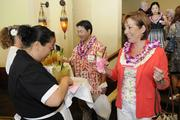 PBN's 2013 Women Who Mean Business finalist June Fernandez of Alliance Personnel is greeted with a beverage at the Women Who Mean Business event held at the Royal Hawaiian Hotel.