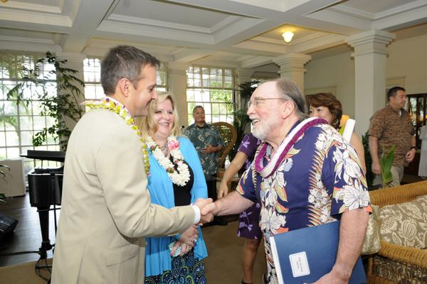 """Hawaii Gov. Neil Abercrombie welcomes Scott Hemerling, left, regional engagement director for Disney Theatrical, and Lerria Schuh, director of marketing with WestCoast Entertainment, at a recent news conference at Washington Place to announce the return of """"The Lion King"""" to Honolulu. The state has issued a request for proposals for renovations to the historic home."""