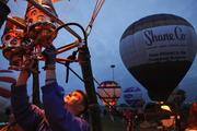 Nick Donner, 2012 Hot Air Balloon World Champion, lit the fire underneath the Tran Orthodontics balloon that he piloted during the Derby Festival's 2013 Great BalloonFest.