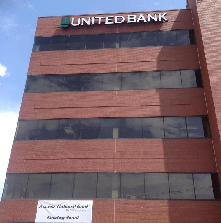 Access National Banks and United Bank are each putting signs atop the office building at 4221 Walney Road in Chantilly.