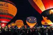 Thousands of spectators showed up to watch the hot-air balloons lit up in the night sky during the 2013 Balloon Glow.
