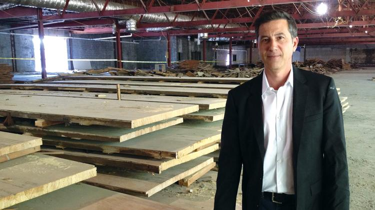 Richard Rosetti says the steel beams of this former bowling alley are structurally sound. He is selling the wood from the lanes to local craftsmen.