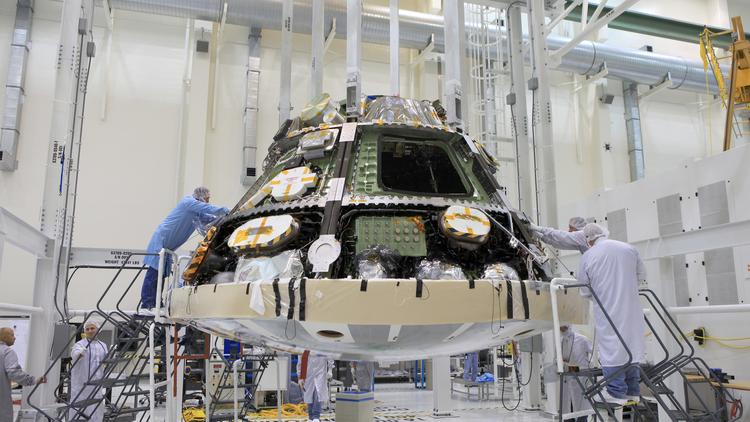 Workers prepare the test-flight version of the Orion deep-space capsule for its first unmanned mission later this year. The Orion Program is managed by NASA's Johnson Space Center in Houston.