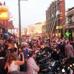 Beale Street to charge a cover, close earlier