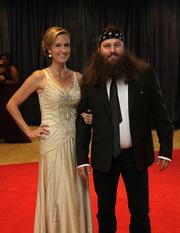 Willie Robertson, CEO of Duck Commander, right, with his wife.