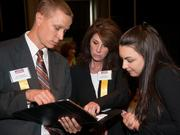 Tom Drennan of UPMC Work Partners talks with Carol DeMico and Kasey McCarl of UPMC Health Plan.