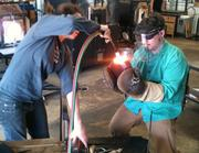 Hot shop coordinator JW May catches the finished product.