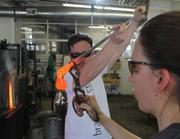 Molten glass is applied to build the shape of the award.