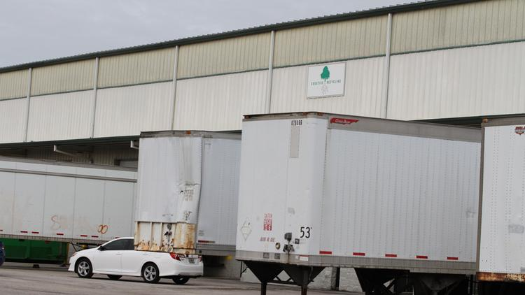 Trucks outside a Creative Recycling Systems building in Tampa. Staff from Swett Consulting is doing inventory of all Creative Recycling Systems facilities around the country.
