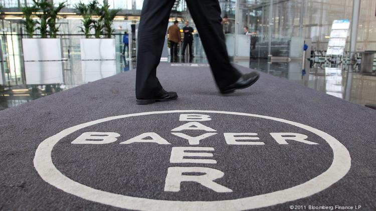 The logo of Bayer AG is seen at the company's headquarters in Leverkusen, Germany. ​Improved performance in Bayer AG's Life Science business helped the company's profit jump 14 percent in the second quarter. Photographer: Hannelore Foerster/Bloomberg
