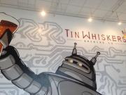 A mural of Tin Whiskers Brewing Co.'s robot mascot takes up an entire wall of its new location in Downtown St. Paul.
