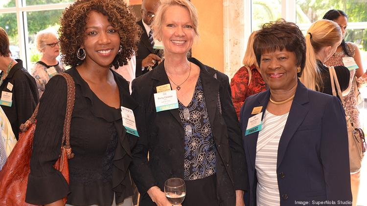 Bridgette Halliburton from Realize Bradenton, Becky Canesse from Just for Girls, and Sandra Holley from Just for Girls mingle before the 2014 Nonprofit of the Year Awards ceremony.