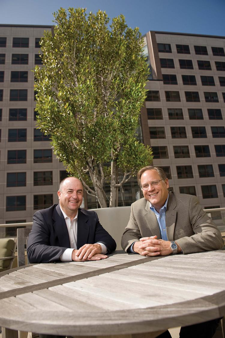 """""""Because of limited for-sale construction, the total level of new housing supply remains in check,"""" says CEO Michael Schall, right, with John Eudy."""