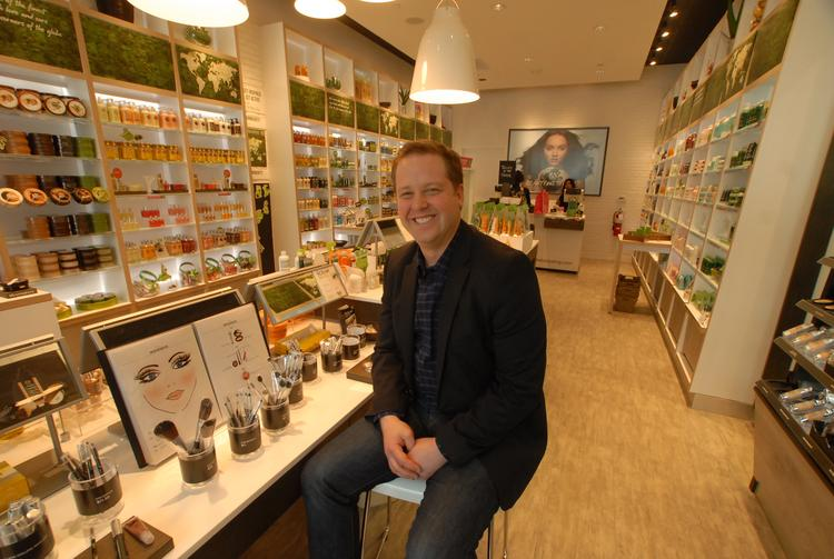 "Jason Feldman, president and general manager of The Body Shop's operations in the U.S. and Mexico, during a visit to the retailer's newly remodeled location at Crabtree Valley Mall in Raleigh says the company is rolling out its new ""pulse"" store design concept to 30 more locations in the U.S. in 2013."