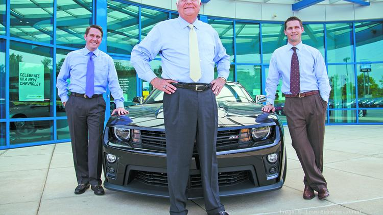 Jim Trenary (yellow tie) poses for a photograph with his sons Tyler Trenary (blue tie) and Kyle Trenary (brown tie)