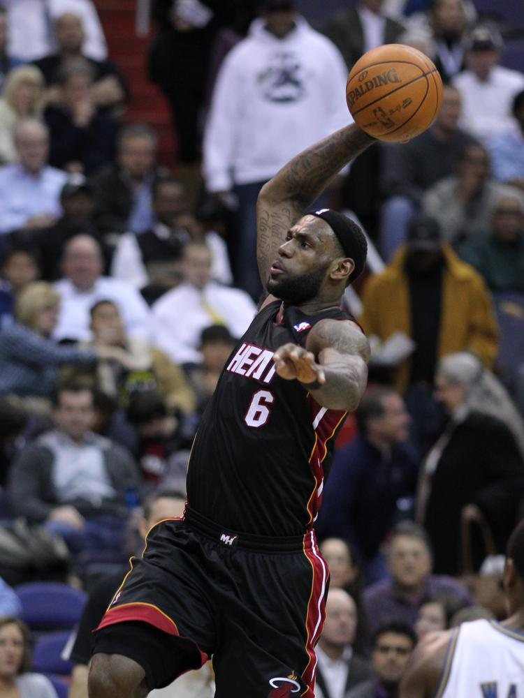 LeBron James, of the Miami Heat, rises with the ball in a game agains the Washington Wizards.