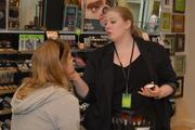 Jen Hapern, right, store manager of The Body Shop's location at Crabtree Mall Valley Mall in Raleigh, demonstrates some of the store's make-up products.