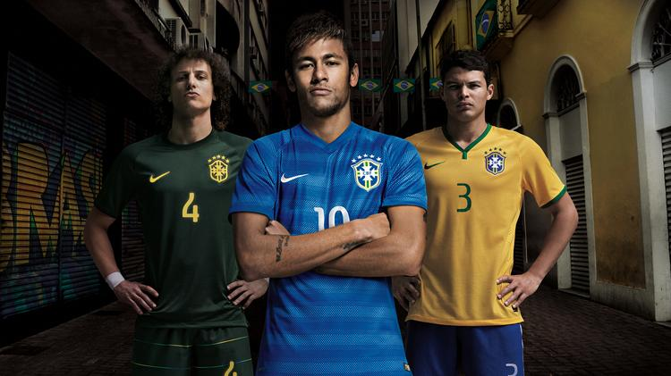 GROUP A - BRAZIL (NIKE): Brazilian national team players David Luiz, Neymar, Thiago Silva display all three Nike-made kits the host nation will wear during the World Cup, which begins next Thursday.