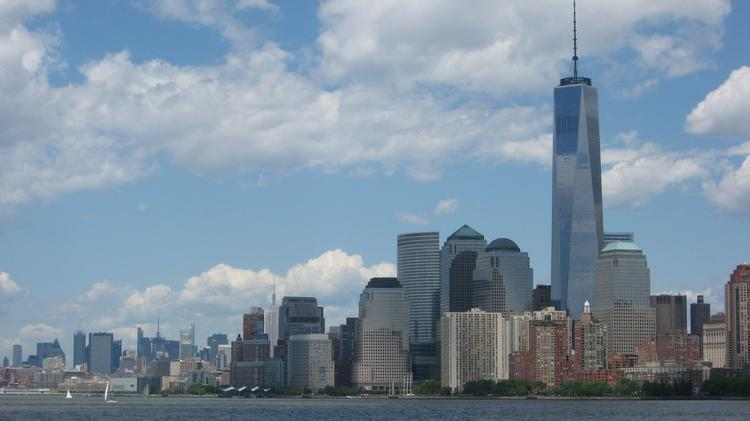 A view of the World Trade Center area from a ferry heading from Ellis Island, Lower Manhattan, New York City, Memorial Day weekend 2014.