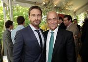 Actor Gerard Butler, left, with Michael Chertoff, chairman of the Chertoff Group and former secretary of the Department of Homeland Security.