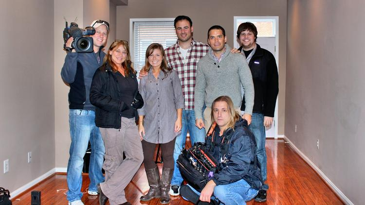 """Julian Morales (middle) and Lacy Conant (to his left) with the team from HGTV's """"House Hunters."""""""