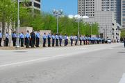 Police are lined up in front of the Thomas F. Eagleton U.S. Courthouse during a protest of supporters and members of the United Mine Workers of America union.