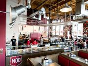 MOD Pizza stores feature a modern, industrial interior.