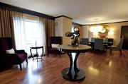 The Presidential Suite also features a large, open entry area and various options for seating.