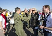 """Sir Richard Branson """"high 10s"""" with SpaceShip2 test pilot Mark Stuckey following the successful first powered flight of SpaceShipTwo. At left is Mark Stuckey's wife Cheryl and at right is Virgin Galactic President and CEO George Whitesides. The spacecraft was dropped from its """"mothership,"""" WhiteKnight2, over the Mojave, Calif. area, April 29, 2013 at high altitude before firing its hybrid power motor. Virgin Galactic hopes to become the first commercial space venture to bring multiple passengers into space on a regular basis."""