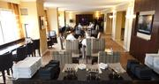 The Concierge Lounge offers a work space for business travelers.